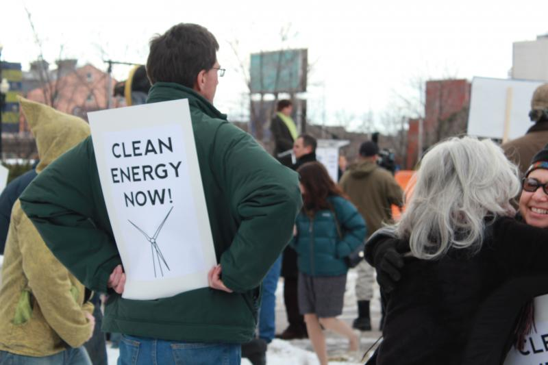 Environmental activists protest outside of the Governor's Energy Development Summit