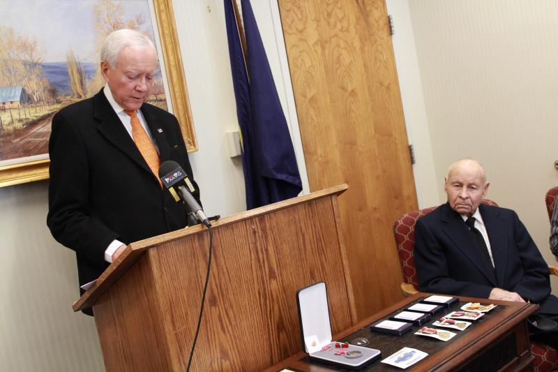 Senator Orrin Hatch presents Lewis Frongner with WW II medals
