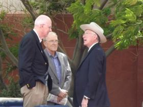 Interior Secretary Ken Salazar (in white hat) speaks with former U.S. Senator Bob Bennett and Washington County Commissioner Alan Gardner in 2012