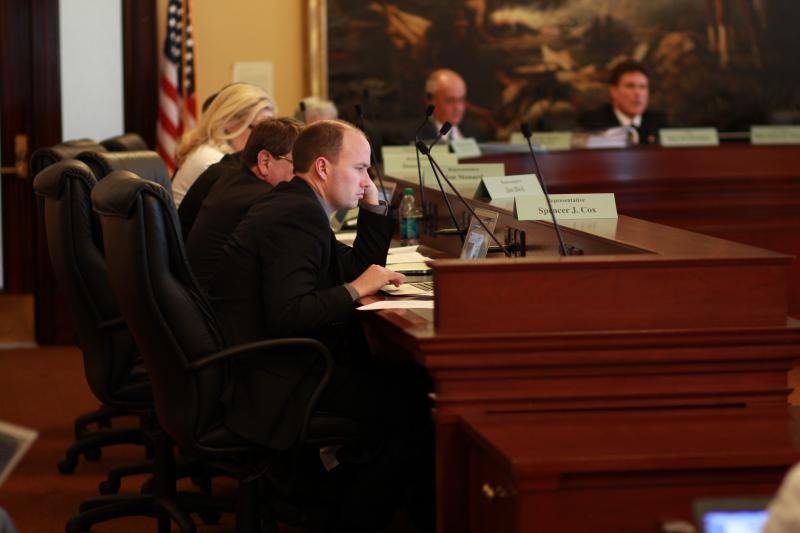Members of House Business and Labor Committee listen to debate on HB350