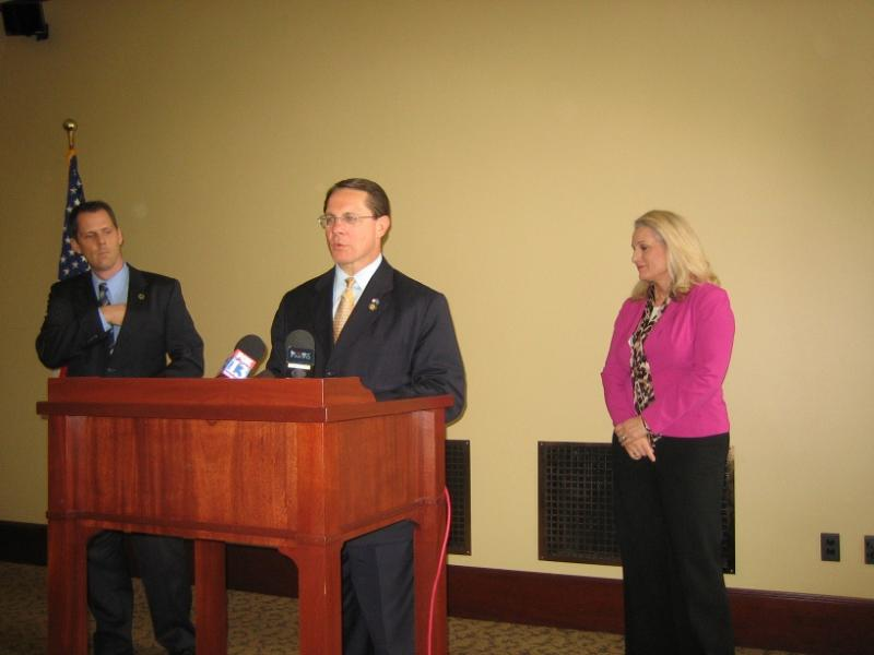 Representatives Jacob Anderegg, Ken Ivory and Dana Layton address a news conference at Utah's state capitol.