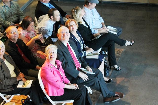Former Dean John W. Mauger as he looks up toward familiar students attending dedication event.. (Pictured in red tie)