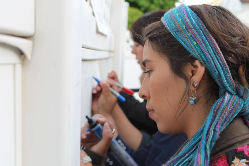 "Participants write their ""dreams"" on a wall."