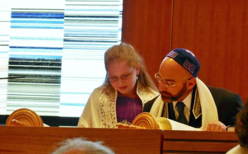 Rabbi Josh Aaronson assists Celia Robbins Davis during her bat mitzvah service at Temple Har Shalom