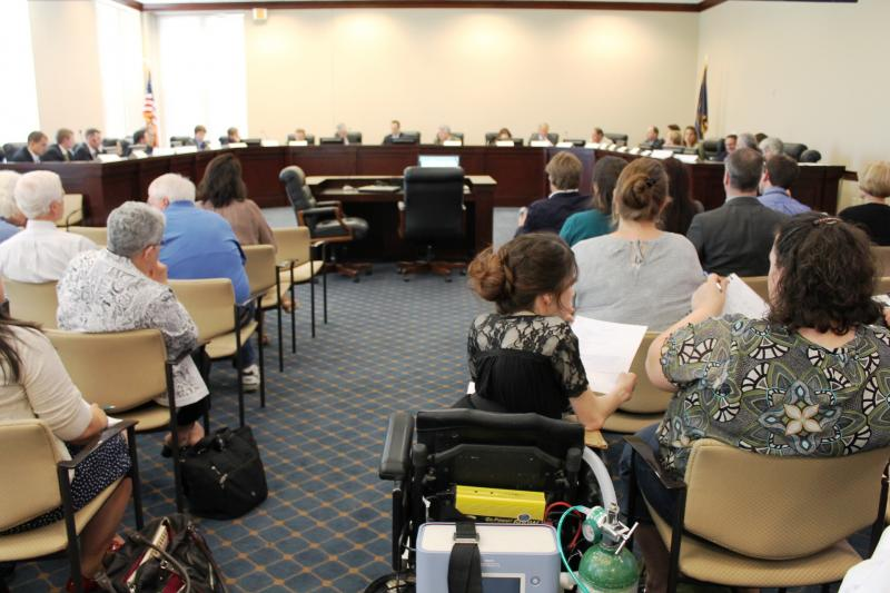 The state's Medicaid Expansion Options Community Workgroup convenes at the capitol.