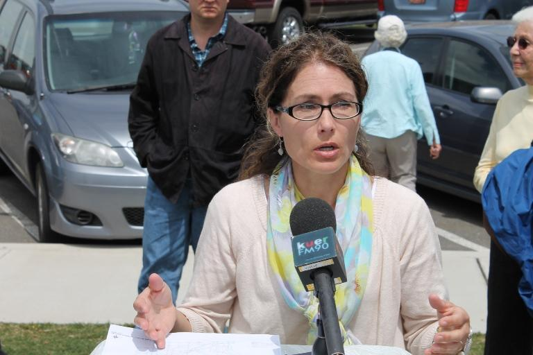 Lori Kalt of Farmington speaks to reporters at a news conference on the West Davis Corridor project