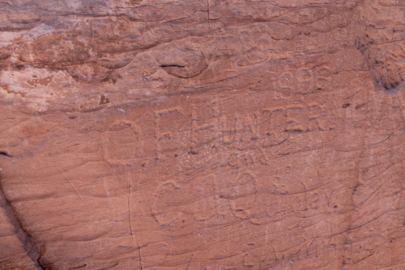 19th Century graffiti chiseled into the sandstone at Hole-in-the-Rock