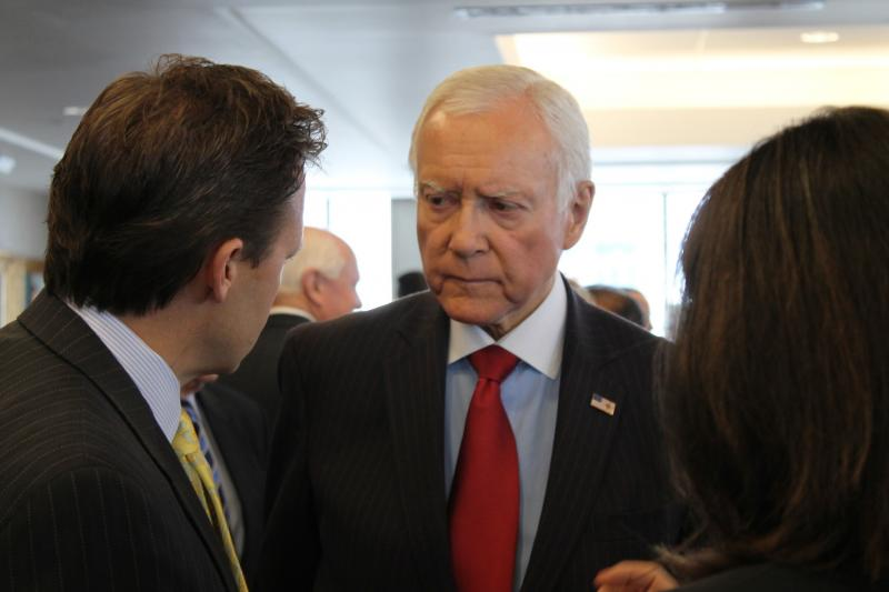 Senator Orrin Hatch (R-Utah) talks with business leaders at Zions Bank about immigration reform.