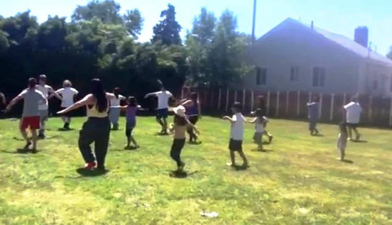 "A ""flash mob"" rehearses for Rose Park picnic to raise awareness about minority mental health."
