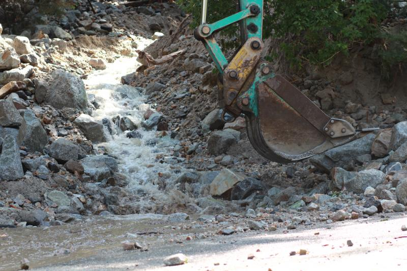 Water continue to run off the mountain and over a road in Little Cottonwood Canyon