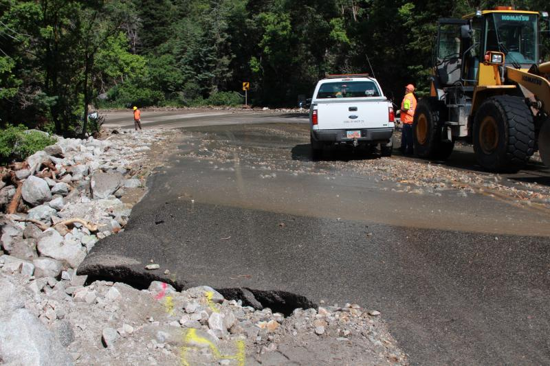 The road in Little Cottonwood canyon buckled after flash floods caused rock slides Friday morning.