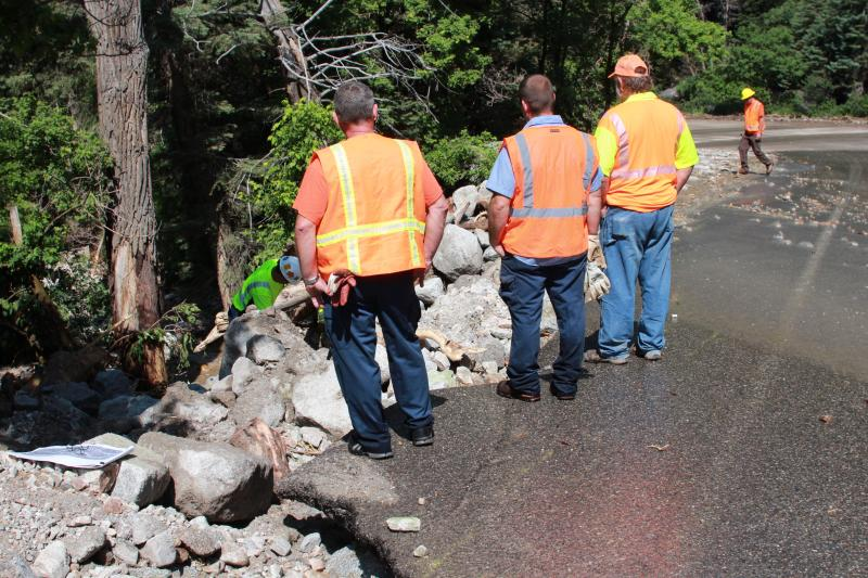 UDOT workers assess the damage from a rock slide in Little Cottonwood Canyon