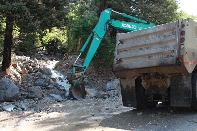 UDOT crews work to clear a clogged drain after  rock slide in Little Cottonwood Canyon