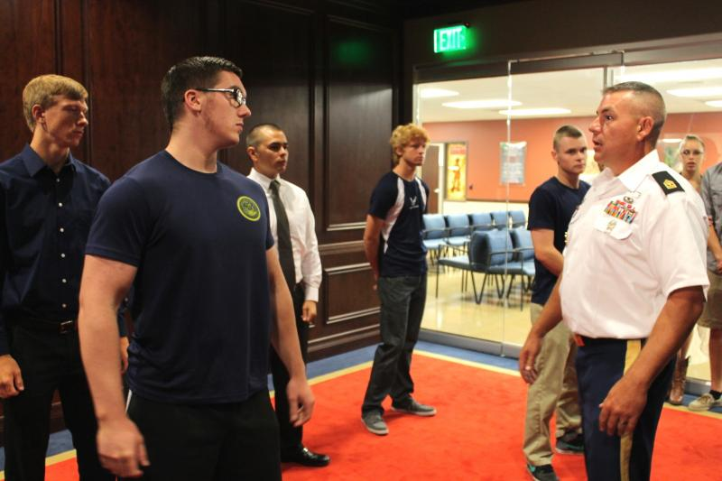 Recruits prepare for military oath ceremony in Salt Lake City's new Military Entrance Processing Station.