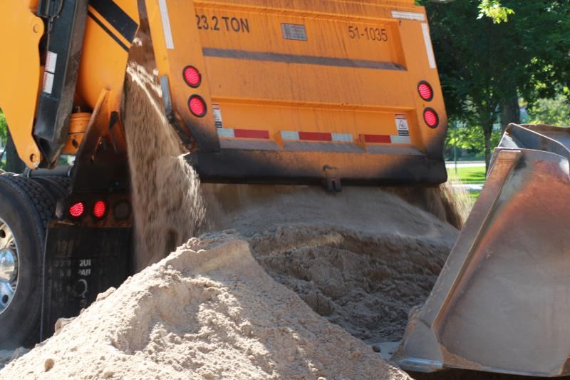 Crews dump tournament quality sand on new volleyball courts
