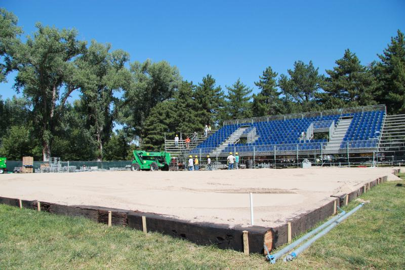 Crews construct the grand stand and court for AVP Salt Lake Open