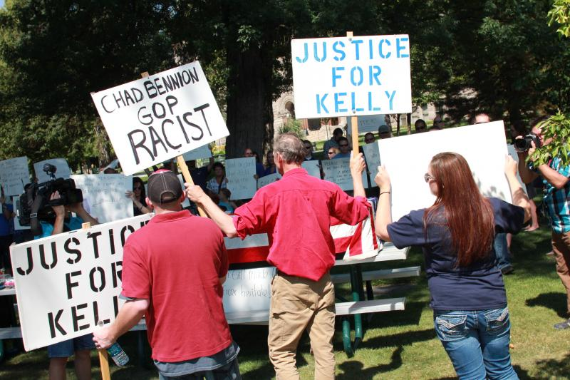 Scott Simons (center) confronts the group organied to rally against Sim Gill