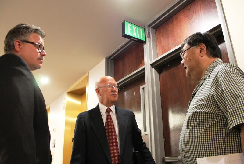 Valley Mental Health CEO Gary Larcenaire and Board President Bruce Cummings talk with County Councilmember Randy Horiuchi at the Salt Lake County Government Center.