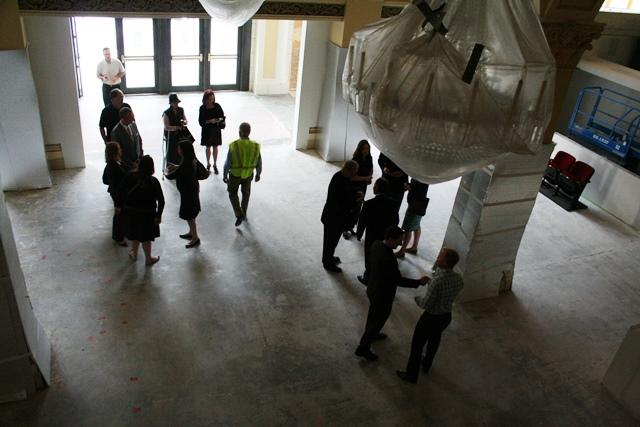 Dignitaries gather in the Capitol Theater lobby for brief celebration as renovation continues.