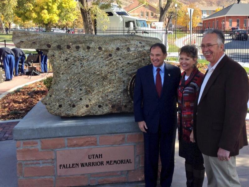 Govenor Gary Herbert stands with Raette Belcher at the Fallen Warrior Memorial