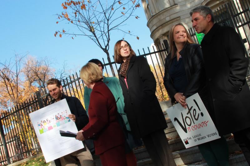 Leaders of the Coalition for a Compassionate Utah gather outside of the Governor's Mansion