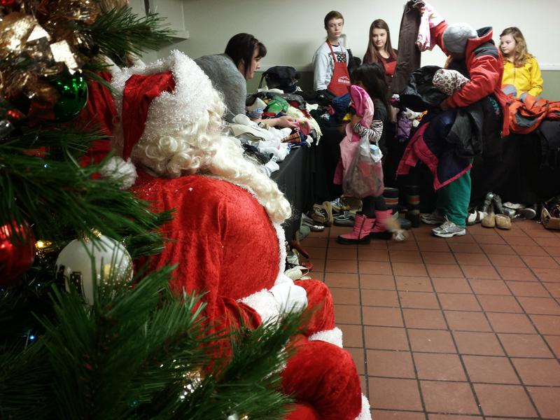 A Volunteer Santa at the Rescue Mission of Salt Lake helps hand out gifts at their annual Christmas Banquet
