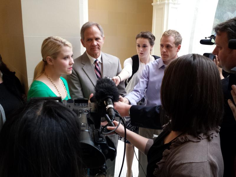 Elizabeth Smart addresses the media outside the House chambers.