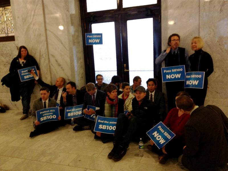Protestors defy orders from the Utah Highway Patrol, and sit in front of the Governor's office.