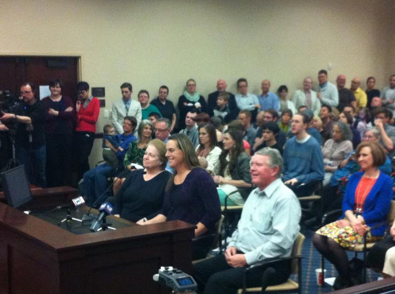 Candice Metzler with her family addressing state lawmakers at a meeting Wednesday night.