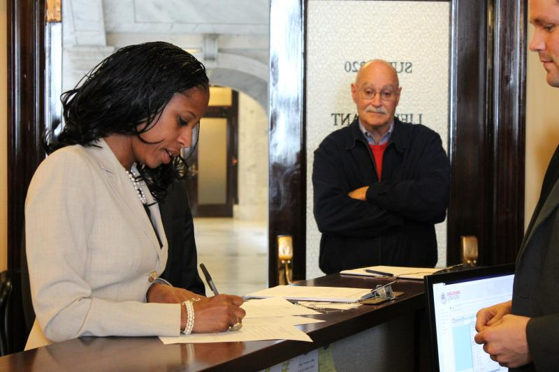 Republican Mia Love files paperwork to run again for Utah's 4th Congressional District, while campaign manager Dave Hansen looks on. (March 17, 2014)