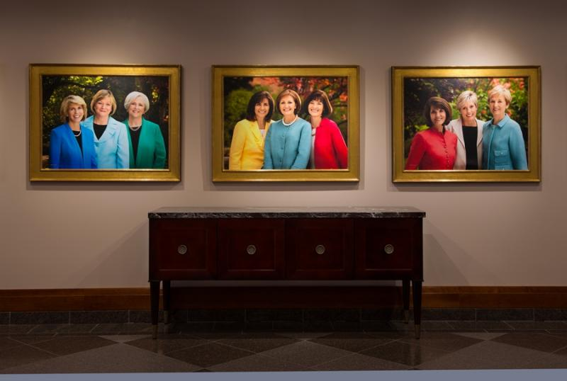 Pictures of the Young Women's, Relief Society and Primary presidencies on display at the Conference Center