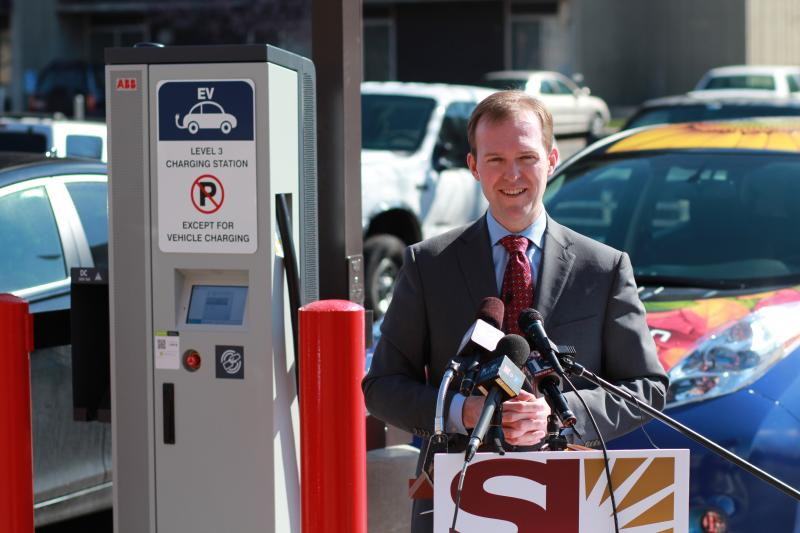 Salt Lake County Mayor Ben McAdams unveils new EV charging station at the County Building.