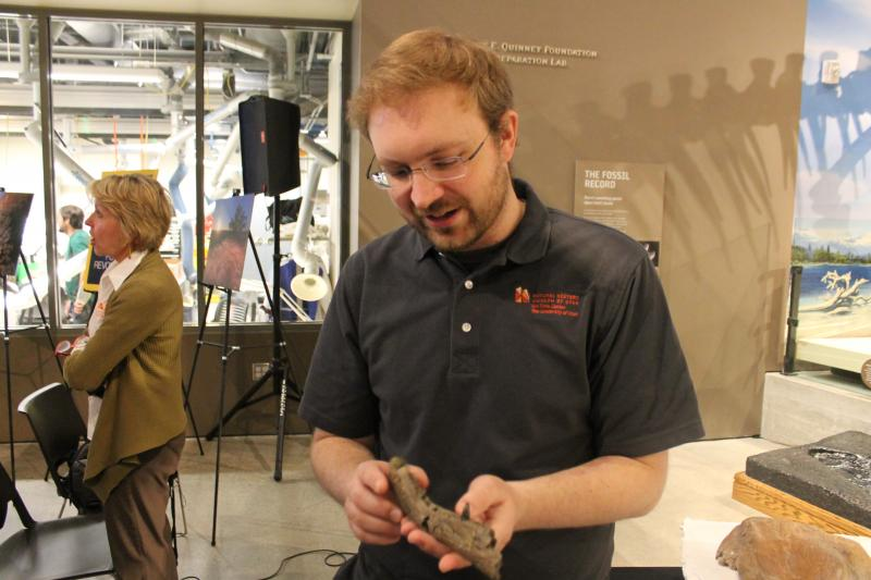 Randall Ermis, curator of paleontology at the Utah Museum of Natural History displaying ancient fossils found in Southern Utah.
