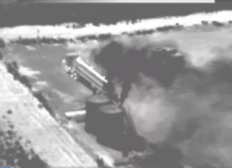 Infrared photography shows raw natural gas escaping from oil field facilities in Texas
