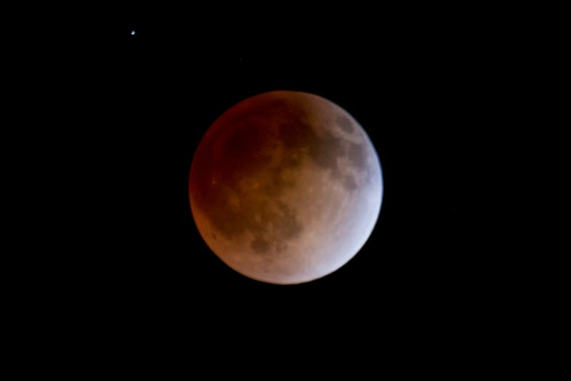 The 'Blood Moon' which is caused by light that is filtered through the Earth's atmosphere and reflects off of the moon.