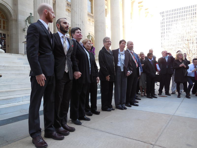 Plaintiffs in the Utah gay marriage case stand outside the federal courthouse in Denver.