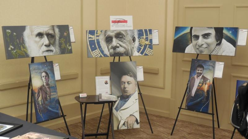 Portraits of scientists, including Charles Darwin, Carl Sagan and Neil deGrasse Tyson displayed for sale at the American Atheists National Convention in Salt Lake City