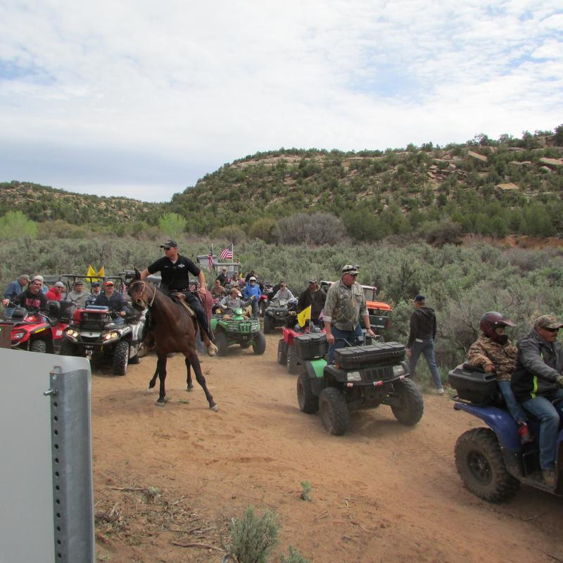 Protesters ride all-terrain vehicles into Recapture Canyon.