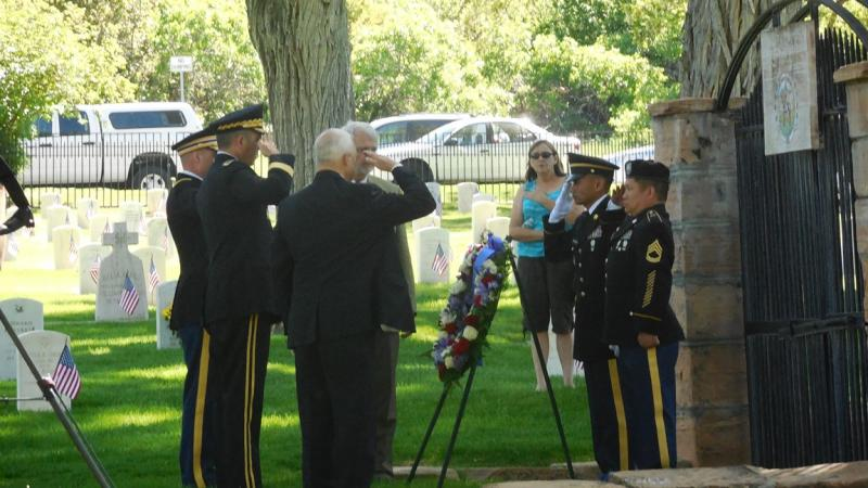 Soldiers from the Utah Army National Guard place a wreath in honor of the war dead buried at Ft. Douglas