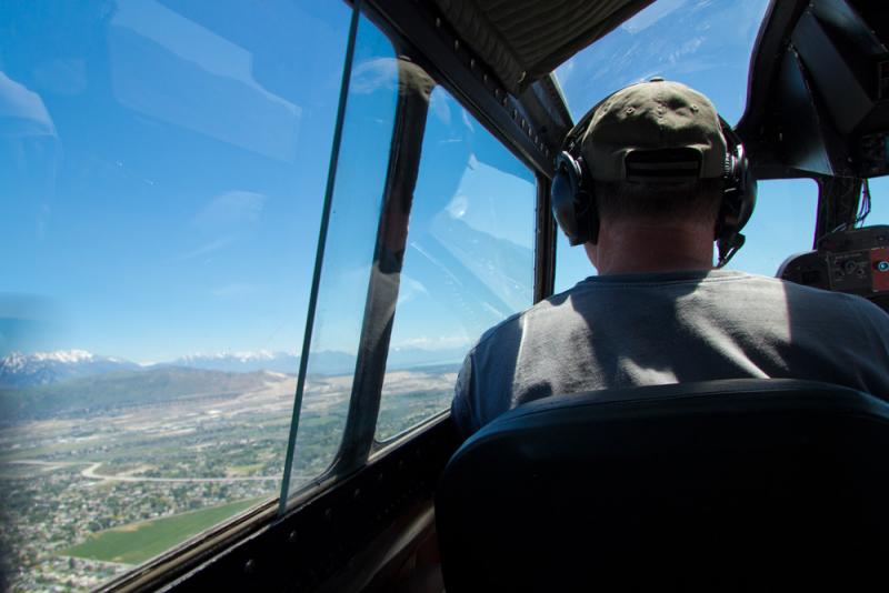 """Bob Hill looks out over the valley while flying the B-17 """"The Movie Memphis Belle"""""""