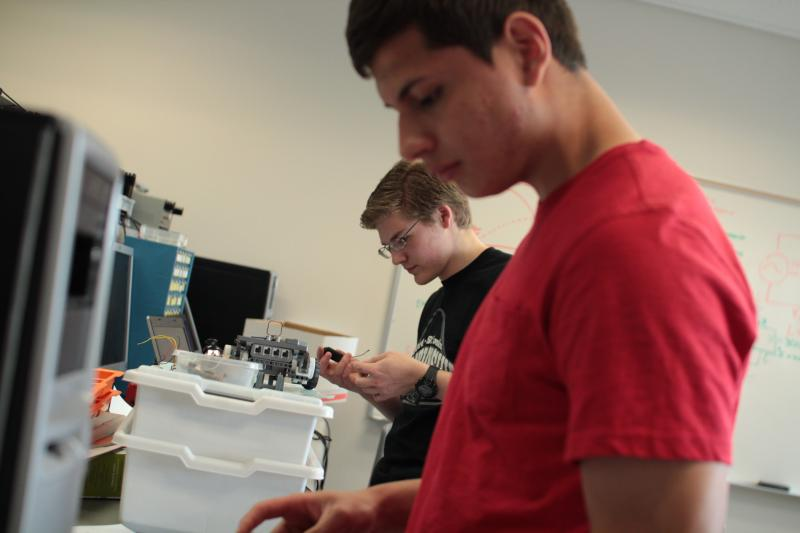 Jonathan Lopez Perez and Benhamin Lovelady work on a project inside a lab at the Granite Technical Institute