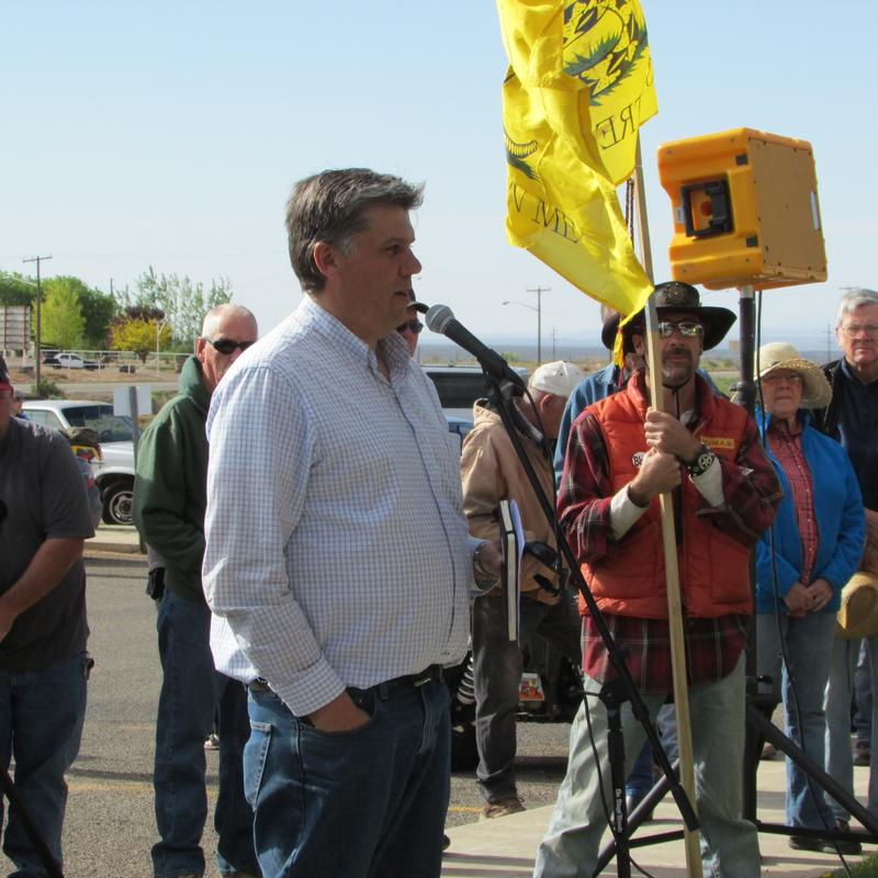 San Juan County Commissioner Phil Lyman leads a rally before protesters ride into Recapture Canyon.