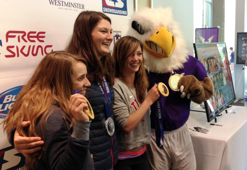Olympic medalists Maddie Bowman, Devin Logan, and Kaitlyn Farrington pose for a photo with the Westminster Griffin.