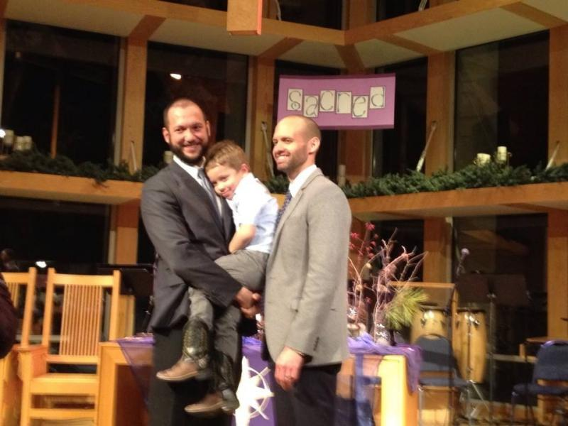 Matthew Barraza and Tony Milner with their son on their wedding day.