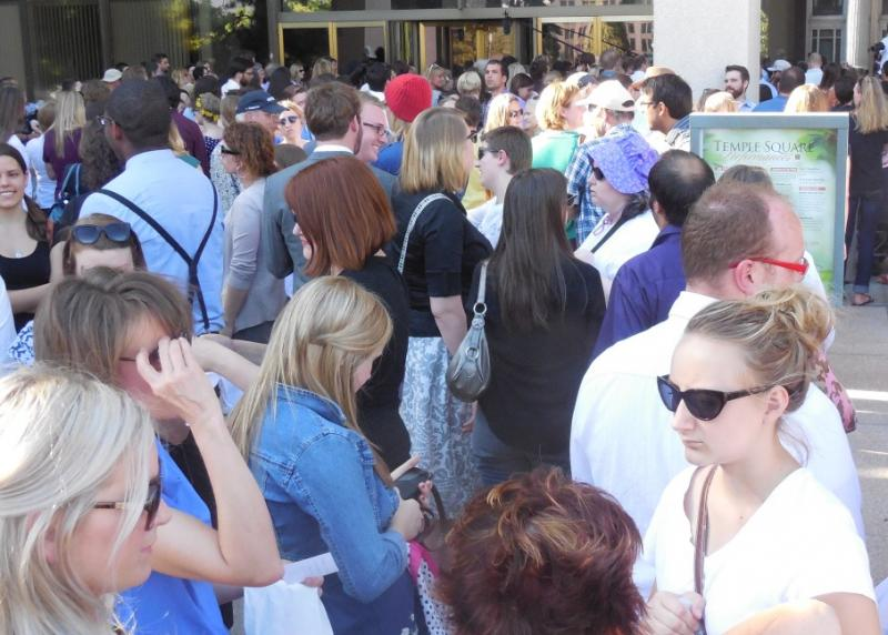 A crowd of several hundred people supporting Ordain Women founder Kate Kelly lays handkerchiefs and other items at the doors of the LDS church office building