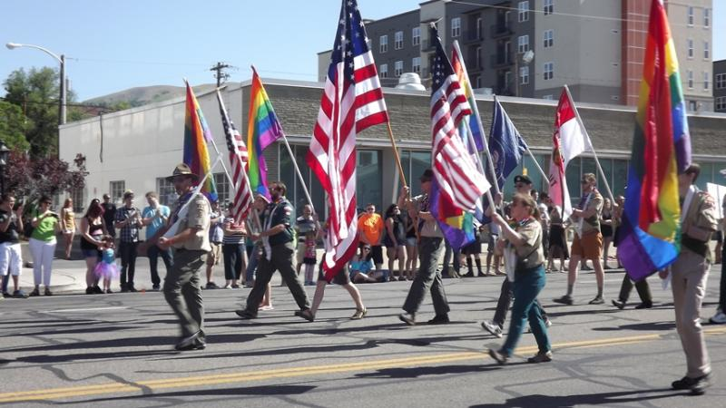 A color guard made up of Boy Scouts and former Scout leaders marches in Salt Lake City's Pride Parade