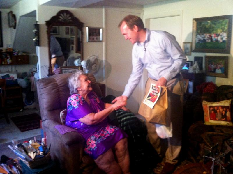 Salt Lake County Mayor Ben McAdams delivers fresh produce to  Cottonwood Heights resident Caroline Poulsen.