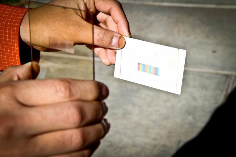 A thin rectangular layer called a polychromat can be integrated into the cover glass of a solar panel. This layer sorts sunlight into colors can be absorbed by solar cells to increase their efficiency without increasing the cost