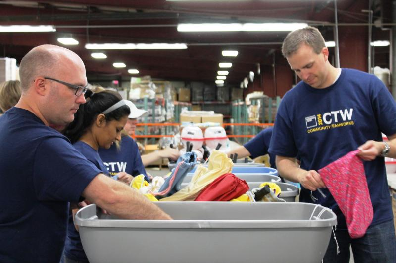 Volunteers load Lifestart boxes for young people aging out of the state's foster care system. (NPS Warehouse, June 18, 2014)