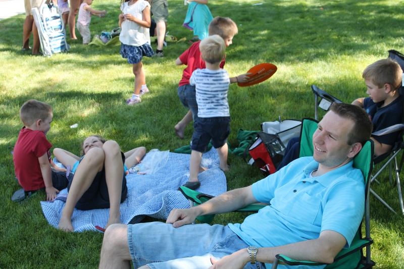 A family relaxes during the Murray Fun Day Parade